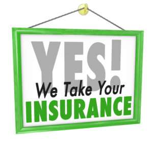 Yes We Take Your Insurance words on hanging doctor office sign to illustrate that your health care provider plan or policy will be accepted for treatment during your visit or appointment